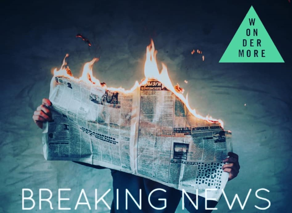 Man holding a burning newspaper with overlaid text saying 'Breaking News'