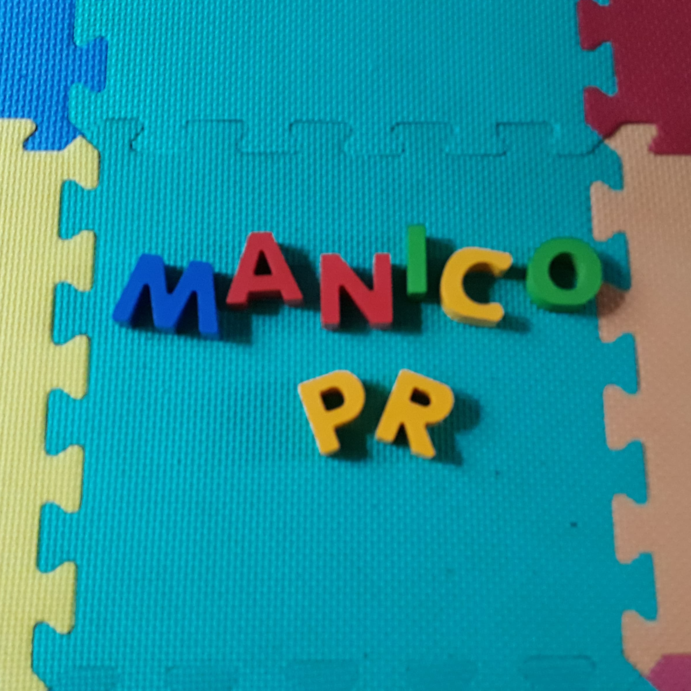 'Manico PR' spelt out with child's toy letters